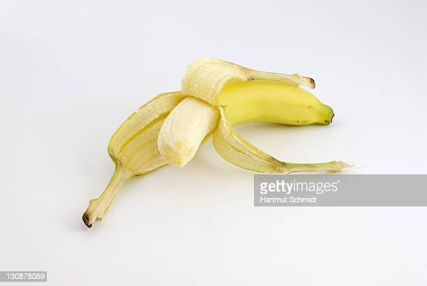 Banana, half peeled