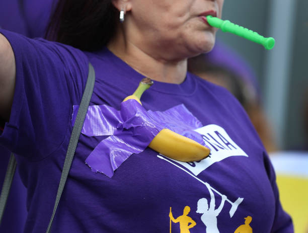 FL: Janitors Tape Bananas To Themselves To Rally Against Low Wages