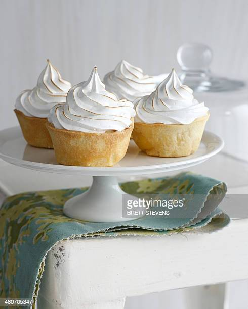 Banana meringue tarts on cake stand