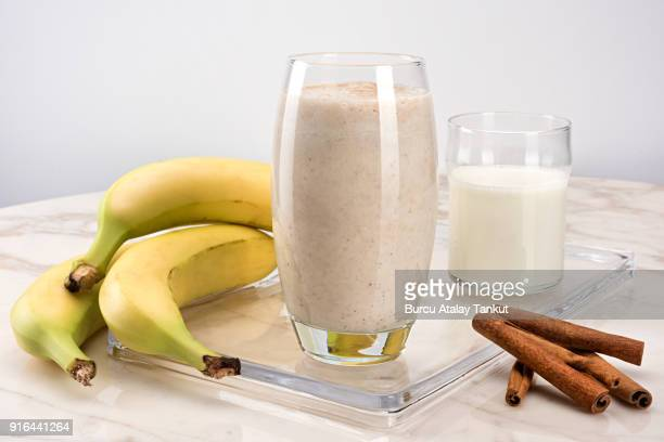 banana milkshake with cinnamon - protein drink stock pictures, royalty-free photos & images