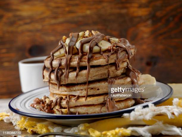 banana pancakes with chocolate sauce - pancakes stock pictures, royalty-free photos & images