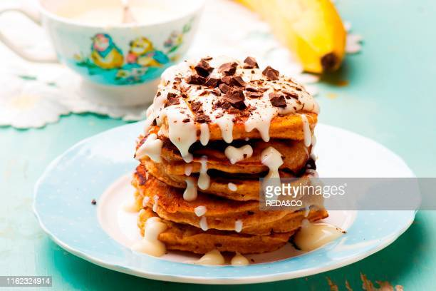 Banana pancakes with cream cheese glaze selective focus