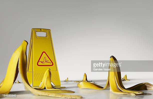 banana peels on the floor - warning sign stock pictures, royalty-free photos & images