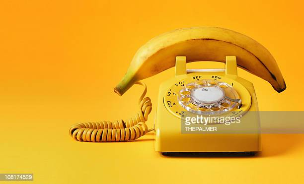 banana phone - practical joke stock photos and pictures