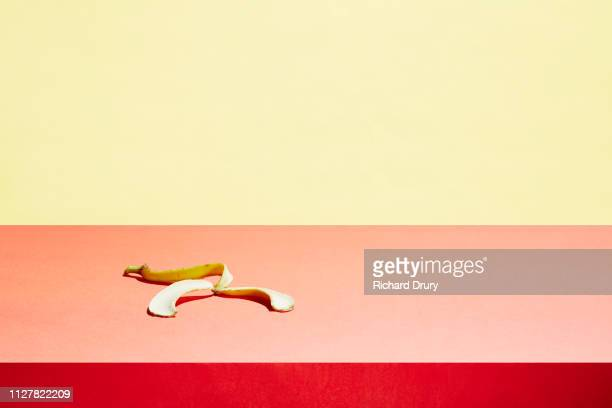 banana skin in a table top - risk stock pictures, royalty-free photos & images