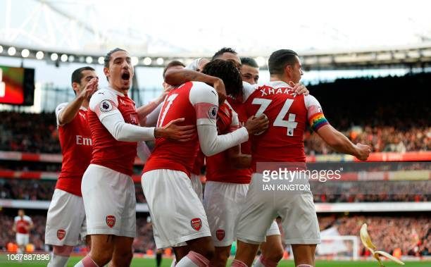 A banana thrown from the crowd is seen as Arsenal's Gabonese striker PierreEmerick Aubameyang celebrates after scoring the opening goal from the...