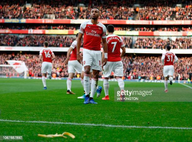 TOPSHOT A banana thrown from the crowd is seen at the side of the pitch as Arsenal's Gabonese striker PierreEmerick Aubameyang celebrates after...
