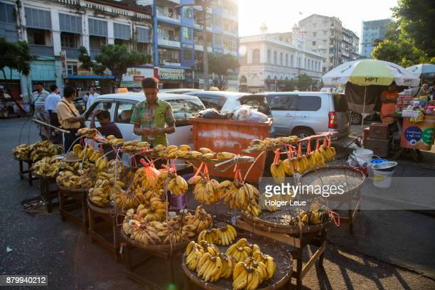 bananas for sale at market stand on street in chinatown, yangon, yangon, myanmar - myanmar culture stock pictures, royalty-free photos & images