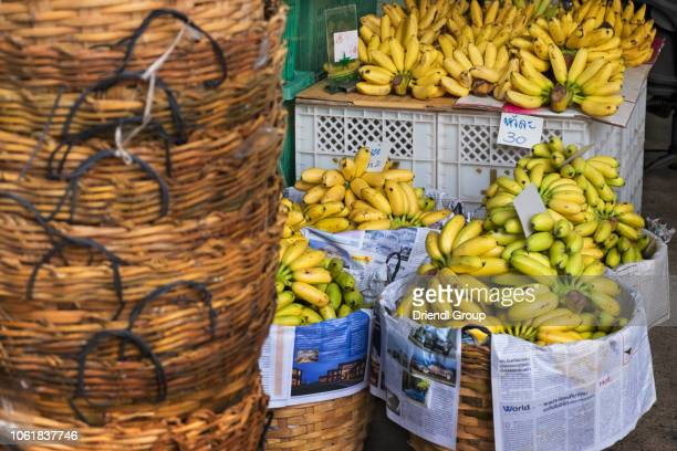 bananas for sale in a market stall. - for stock pictures, royalty-free photos & images