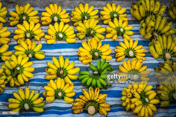 bananas is being sold at the market - thien hau pagoda stock pictures, royalty-free photos & images