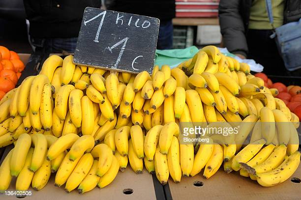 Bananas sit priced at one euro per kilo on a fruit and vegetable stall at a market in Madrid Spain on Wednesday Jan 4 2012 The country's unemployment...