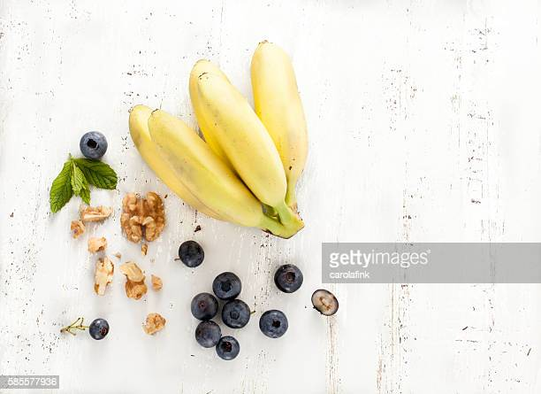 bananas with berries and nuts - carolafink stock photos and pictures