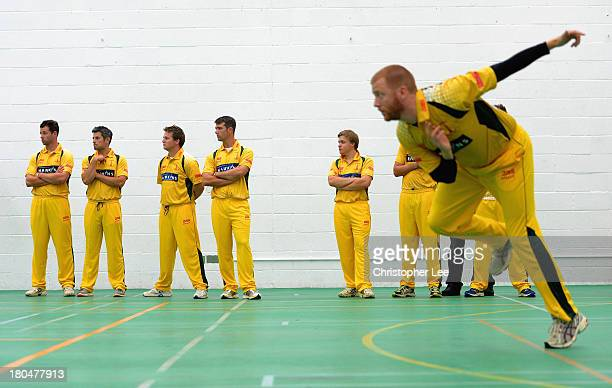 Banbury members watch their captain Jimmy Phillips as he bowls in the Bowl Off after their game was abandoned due to rain during the Semi Final match...