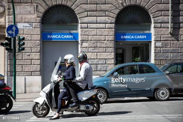 Banca Carim Cassa di Risparmio di Rimini SpA logo sits outside one the company's bank branches in Rome, Italy, on Tuesday, May 2, 2017. Credit...