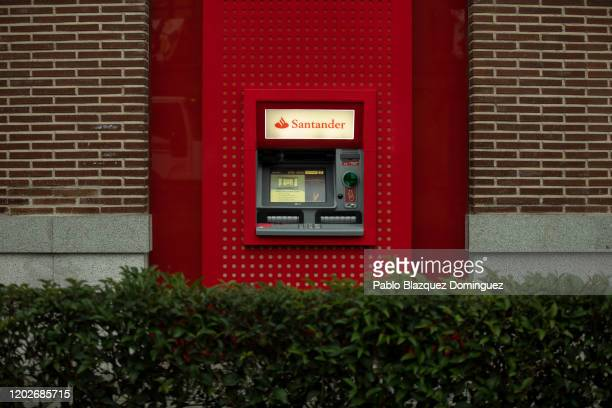 Banco Santander's cash machine is seen at a bank's branch before a news conference to announce the 2019 results on January 29, 2020 in Boadilla del...