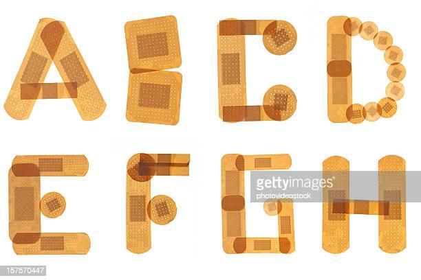 band hilfe alphabet - erste hilfe hinweisschild stock-fotos und bilder
