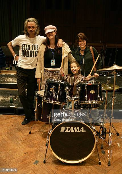Band Aid trustee Sir Bob Geldof and his daughters Fifi Trixibelle Pixie and Tiger Lily at the recording of the 20th anniversary remake of Midge Ure...