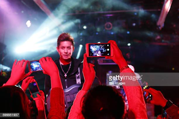band and fans - celebrities photos stock pictures, royalty-free photos & images