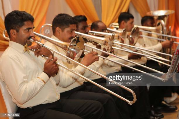 Band artists perform during the wedding reception of INLD MP Dushyant Chautala with Meghna Ahlawat at Ashoka Hotel on April 20 2017 in New Delhi...