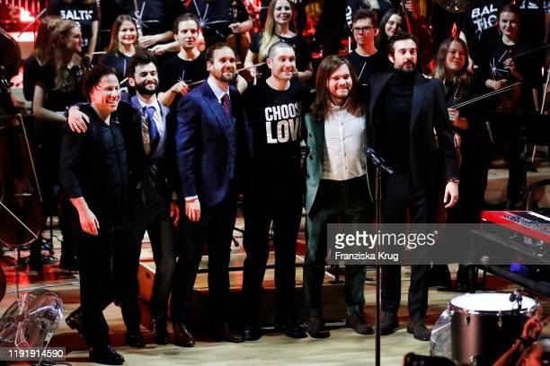 Band Bastille Christopher Wood Kyle Simmons Will Farquarson Dan Smith and conductor Kristjan Jaervi during the Channel Aid Live in concert at...