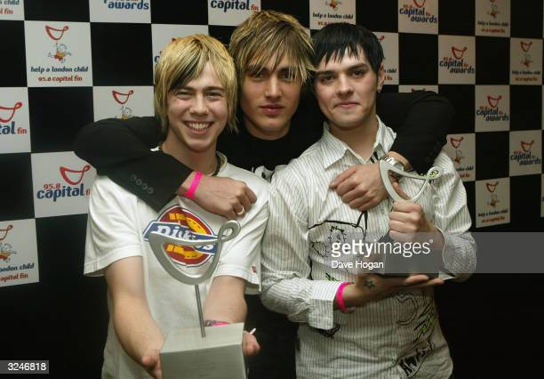 """Band Busted with their awards for Favourite UK Group and News of the World Favourite Pop Act pose in the awards room at the """"Capital FM Awards 2004""""..."""