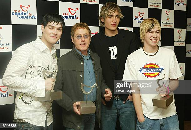 Band Busted with their awards for Favourite UK Group and News of the World Favourite Pop Act with Roger Daltrey from The Who, who collected an award...