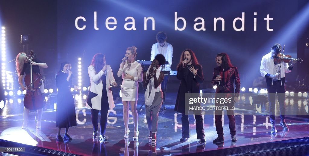 Band Clean Bandit performs with the singers of The Voice during the Italian State RAI TV's program final 'The Voice of Italy', in Milan on June 5, 2014.