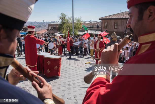 A band dressed in traditional Ottomanera clothing plays Turkish national songs in front of the Ulus Castle in Ankara Turkey on 22 September 2018