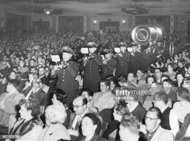 A band from Lowry air force base marches down an aisle of the packed Paramount theatre during ceremonies marking the Denver opening of 'The Glenn...