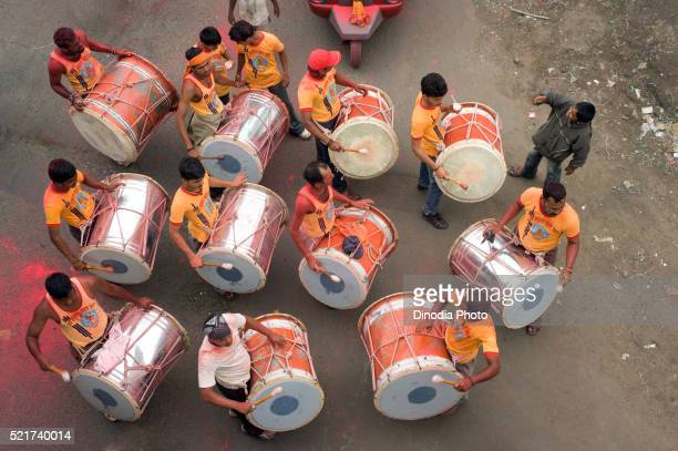 Band group beating big drum to Ganpati festival at Pune, Maharashtra, India, Asia