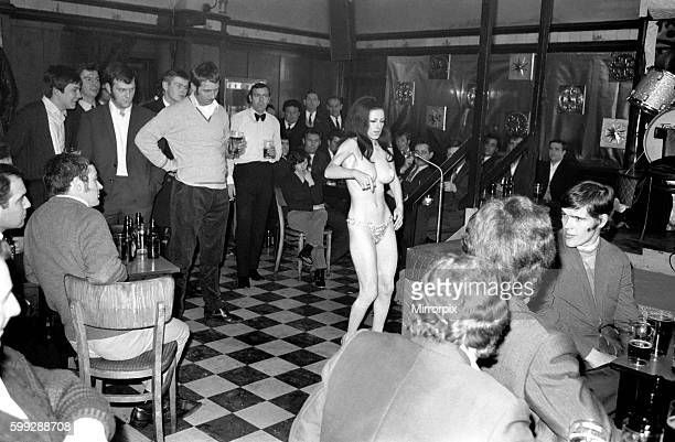 A band is playing compress sing and tell jokes and syas from time to time wait for it And then eventually it appears and it is Stripper Jackie Jackie...