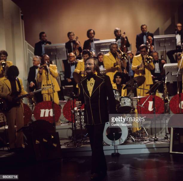 Band leader James Last performs on a television show with his orchestra in the 1970's