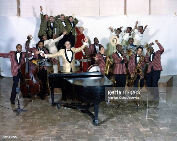 Band leader Johnny Otis and the Johnny Otis orchestra pose for a portrait in circa 1957 Johnny Oitis in foreground at microphone Mel Williams in...