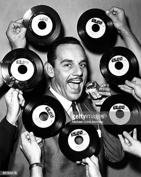 Band leader Johnny Otis poses for a portrait in surrounded by The Jelly Roll records in 1947