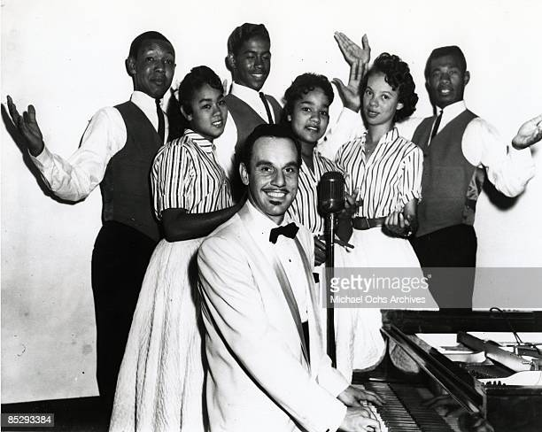 Band leader Johnny Otis poses for a portrait with the vocal sextet The Six Teens in December 1957