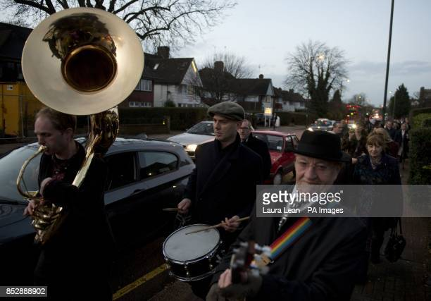 A band leads mourners to the wake after the funeral of Ronnie Biggs at Golders Green Crematorium north London