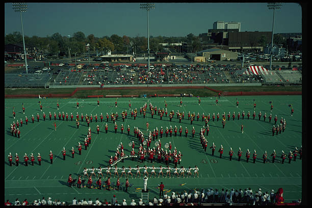 Band Marching in Formation at College Football Game