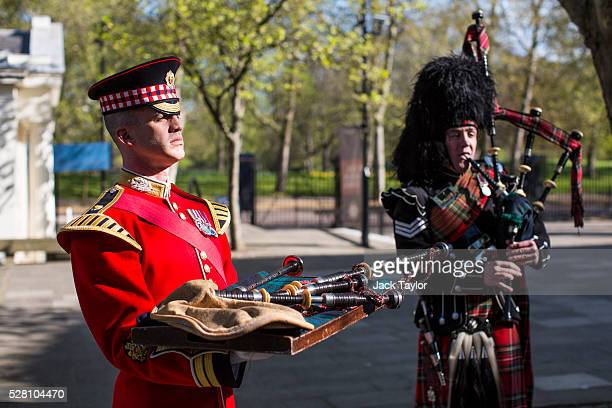 Band Master Will CassonSmith holds a set of 100yearold bagpipes as Piper Lance Sergeant John Mitchell plays during a procession at Wellington...