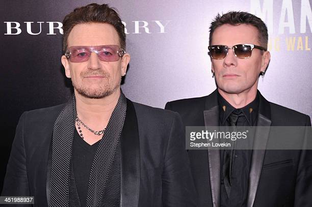 U2 band members Bono and Larry Mullen Jr attend 'Mandela Long Walk To Freedom' screening hosted by U2 Anna Wintour Bob and Harvey Weinstein with...