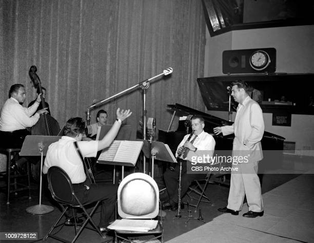 Band members, Cliffie Stone ; Billy Leibert accordionist; Billy Strange ; Larry Tice and host, Tennessee Ernie Ford are photographed for the CBS...
