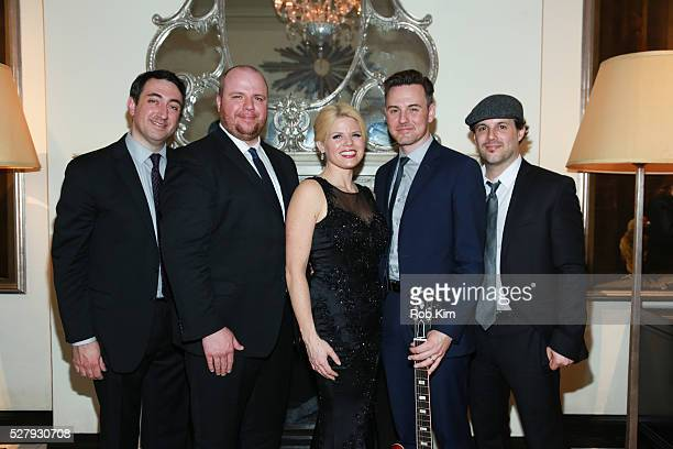 Band members Dennis Keefe Ryan Hoagland Megan Hilty Brian Gallagher and Matt Cusson pose for a photo after performing at their show at Cafe Carlyle...