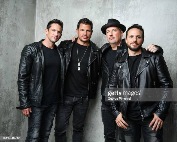 Band Members Jeff Timmons Nick Lachey Justin Jeffre and Drew Lachey from 98 Degrees pose in the 2018 iHeartRADIO MuchMusic Video Awards Portrait...