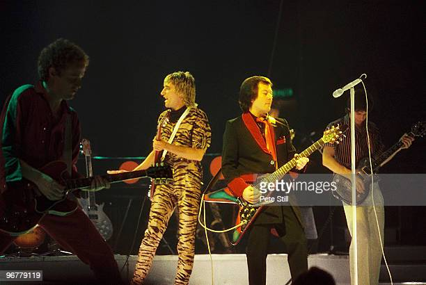 Band members Jim Cregan Billy Peek and Gary Grainger perform with Rod Stewart on stage at Wembley Area on December 3rd 1980 in London United Kingdom