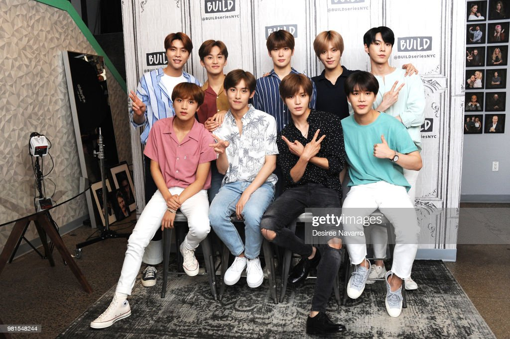 NCT 127 band members (L-R top) Johnny, Mark, Jaehyun, Yuta, Doyung and (L-R lower) Haechan, Win Win, Taeyong, Taeil visit Build Series to discuss KCON at Build Studio on June 22, 2018 in New York City.