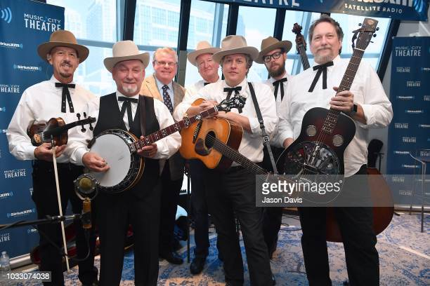 Band members Johnny Warren Charlie Cushman Jeff White Shawn Camp and Jerry Douglas of Earls of Leicester along with SiriusXM's Kyle Cantrell at...