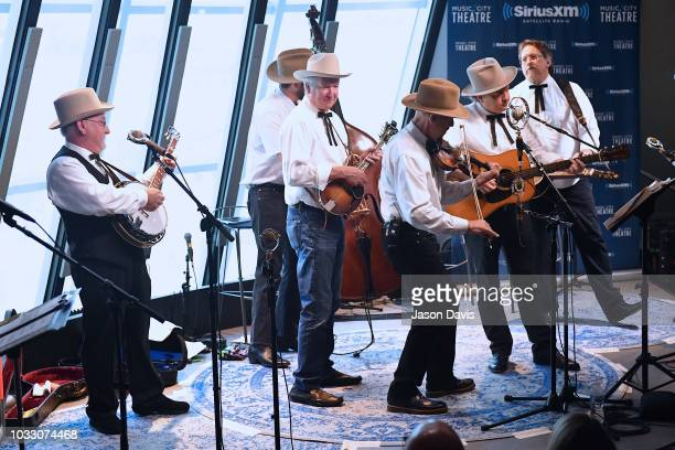 Band members Johnny Warren Charlie Cushman Jeff White Shawn Camp and Jerry Douglas of Earls of Leicester perform on stage at SiriusXM Studios on...