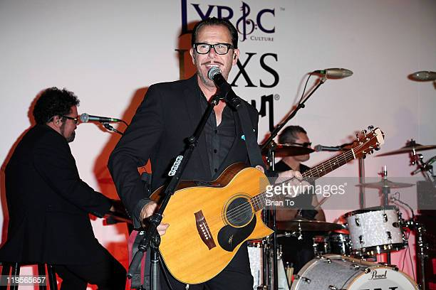 INXS band members Kirk Pengilly and Andrew Farriss perform at Lyric Culture presents 'Electro Sexual' collection with INXS at the Gibson showroom on...