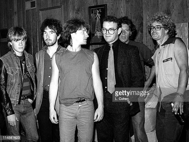 Band members Larry Mullen Jr., The Edge, Bono, band manager Paul McGuinness, Island Records Founder Chris Blackwell, and Adam Clayton