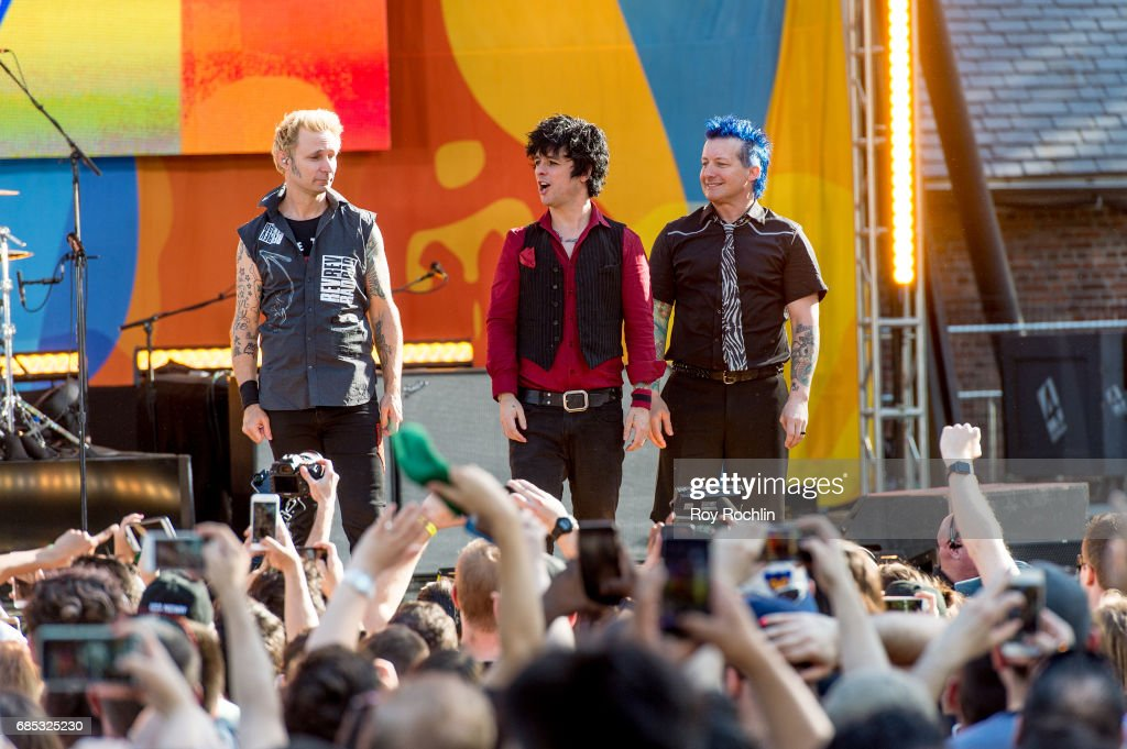 Band members Mike Dirnt, Billie Joe Armstrong and Tre Cool as Green Day perform on ABC's 'Good Morning America' at Central Park on May 19, 2017 in New York City.