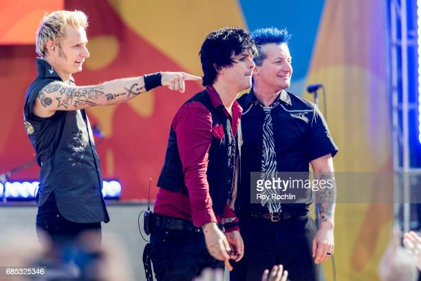 Band members Mike Dirnt Billie Joe Armstrong and Tre Cool as Green Day perform on ABC's 'Good Morning America' at Central Park on May 19 2017 in New...